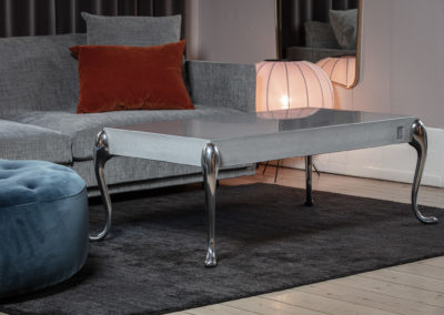 Flightdeck concrete coffee table with polished table legs. Design Morten Voss